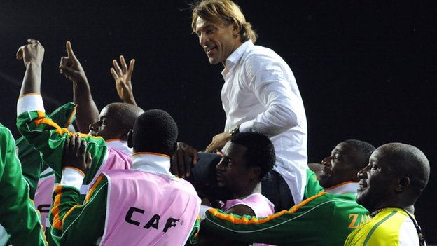 Herve Renard lifted shoulder high by Zambian football players after winning the Nations Cup in 2012.