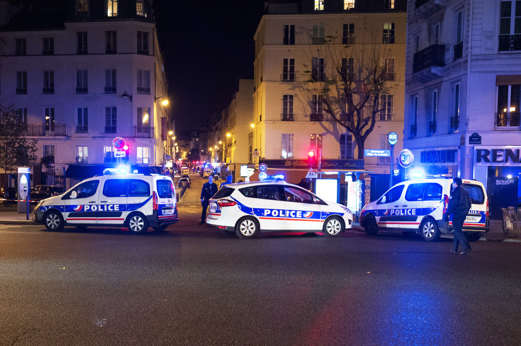 PARIS, FRANCE - NOVEMBER 13: A general view of police at the scene on Boulevard Beaumarchais following a shooting on November 13, 2015 in Paris, France. 26 people have reportedly been killed following a series of violent incidents in and around Paris. (Photo by David Wolff - Patrick/Getty Images)