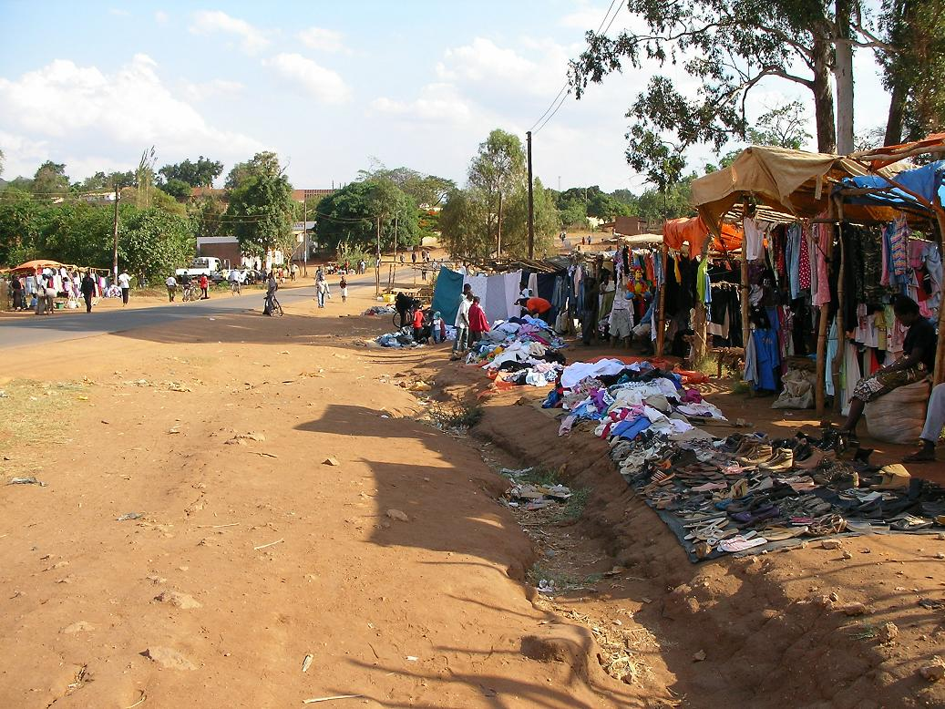 Traders line up secondhand clothes for sale along the road in Chipata, Zambia